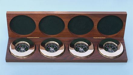 Four Large Paperweight Compasses in Hardwood Case